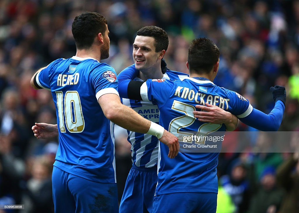 Jamie Murphy (C) of Brighton celebrates with team mates Anthony Knockhaert (R) and Tomer Hemed (L) after scoring the first goal of the game during the Sky Bet Championship match between Brighton and Hove Albion and Bolton Wanderers at The Amex Stadium on February 13, 2016 in Brighton, England.