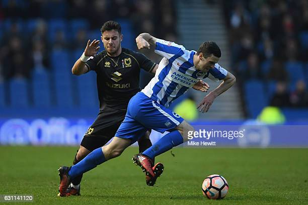 Jamie Murphy of Brighton is fouled by George Baldock of MK Dons during The Emirates FA Cup Third Round match between Brighton Hove Albion and Milton...