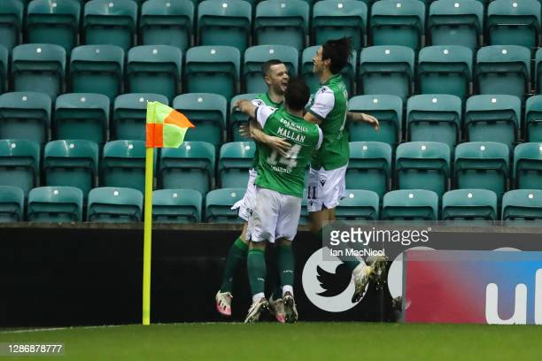 Jamie Murphy of Hibernian celebrates with teammates Joe Newell and Stevie Mallan after scoring his team's first goal during the Ladbrokes Scottish...