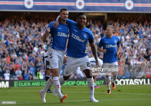 Jamie Murphy of Rangers is congratulated by his team mates after scoring the opening goal of the game during the PreSeason Friendly between Rangers...