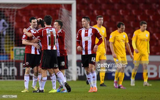 Jamie Murphy of Sheffield United celebrates scoring to make it 10 with team mates during the FA Cup Fourth Round match between Sheffield United and...