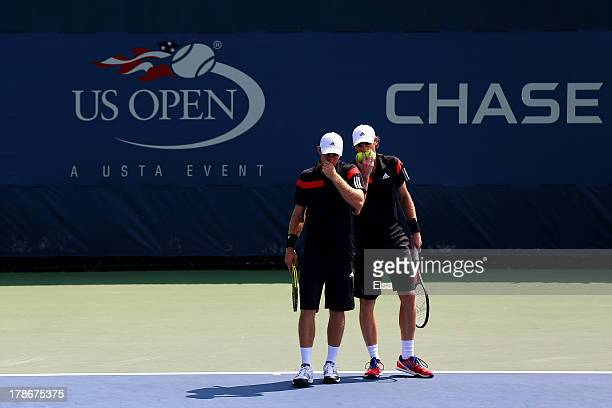 Jamie Murrary of Great Britain and John Peers of Australia talk tactics during their men's doubles second round match against Feliciano Lopez of...