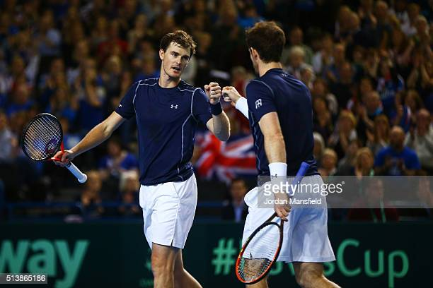 Jamie Murray and Andy Murray of Great Britain celebrate a point during the doubles match against Yoshihito Nishioka and Yasutaka Uchiyama of Japan on...