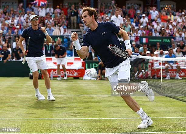 Jamie Murray and Andy Murray of Great Britain celebrate in their match against Nicolas Mahut and JoWilfried Tsonga of France during Day Two of the...
