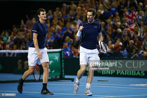 Jamie Murray and Andy Murray of Great Britain celebrate victory during the doubles match against Yoshihito Nishioka and Yasutaka Uchiyama of Japan on...