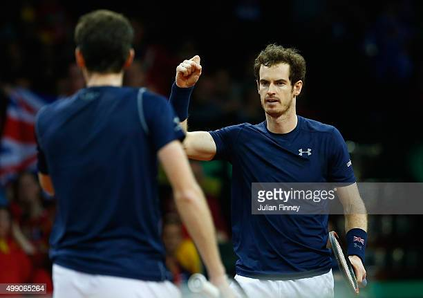 Jamie Murray and Andy Murray of Great Britain celebrate winning a point against Steve Darcis and David Goffin of Belgium in the doubles during day...