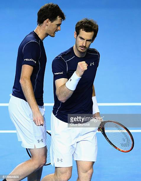 Jamie Murray and Andy Murray of Great Britain cleebrate a point in the doubles match against Yasutaka Uchiyama and Yoshihito Nishioka of Japan on day...