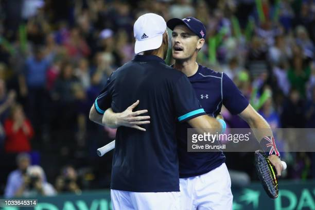Jamie Murray and Dominic Inglot of Great Britain celebrate match point against Denis Istomin and Sanjar Fayziev of Uzbekistan during day two of the...