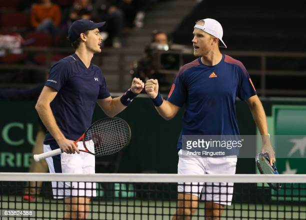 Jamie Murray and Dominic Inglot of Great Britain fistbump after winning a set point against Vasek Pospisil and Daniel Nestor of Canada during the...