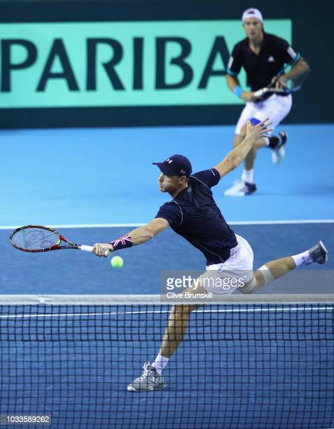 Jamie Murray and Dominic Inglot of Great Britain in action against Denis Istomin and Sanjar Fayziev of Uzbekistan during day two of the Davis Cup by...