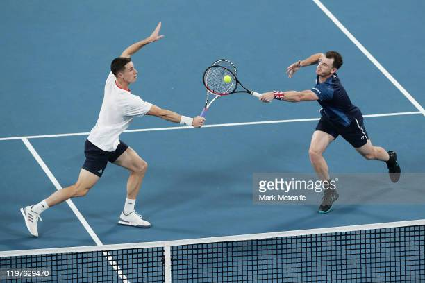 Jamie Murray and Joe Salisbury of Great Britain both go for a return during their Group C doubles match against Sander Gille and Jordan Vliegen of...