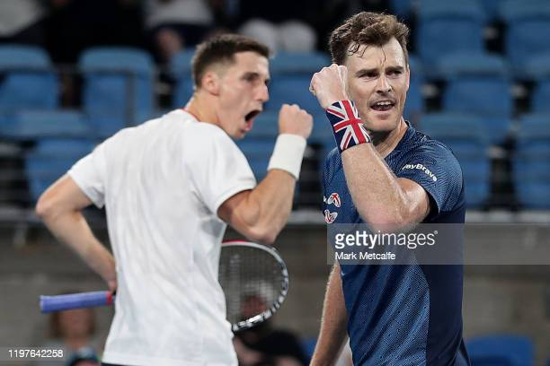 Jamie Murray and Joe Salisbury of Great Britain celebrate winning a point during their Group C doubles match against Sander Gille and Jordan Vliegen...