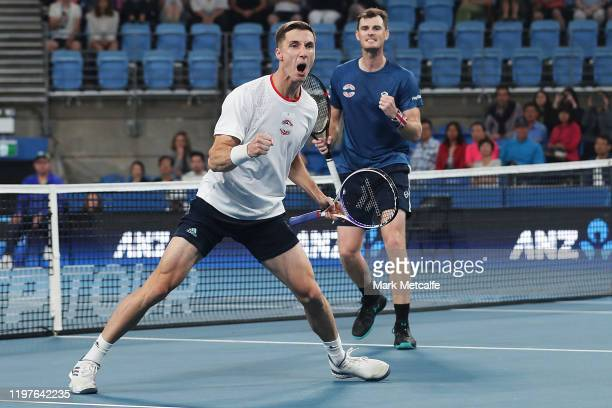 Jamie Murray and Joe Salisbury of Great Britain celebrate winning match point during their Group C doubles match against Sander Gille and Jordan...