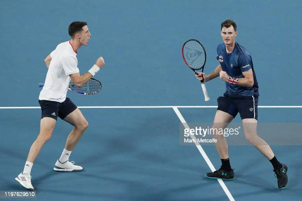 Jamie Murray and Joe Salisbury of Great Britain celebrate winning set point during their Group C doubles match against Sander Gille and Jordan...