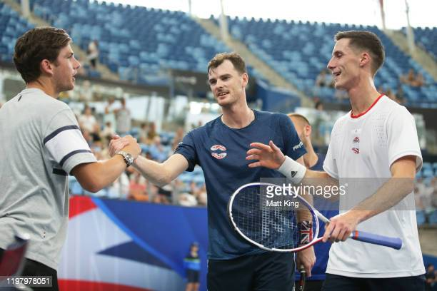 Jamie Murray and Joe Salisbury of Great Britain celebrate with team mateCameron Norrie after winning their Group C doubles match against Radu Albot...