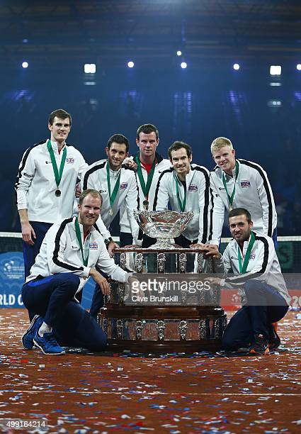 Jamie Murray, Dom Inglot, James Ward, Leon Smith, Andy Murray, Kyle Edmund and Dan Evans of Great Britain pose with the Davis Cup following victory...