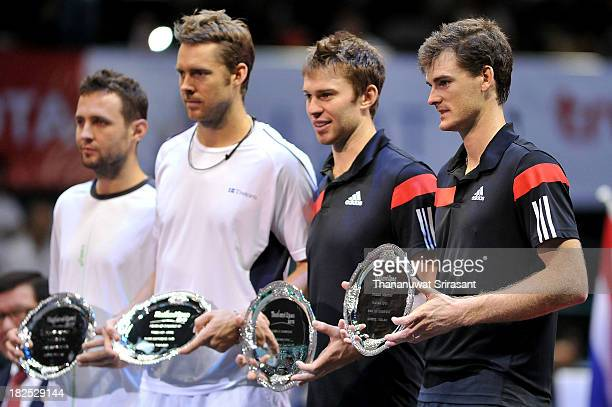 Jamie Murray of Britain and team mate John Peers of Australia pose with their Thailand Open trophies after defeating Tomasz Bednarek of Poland and...