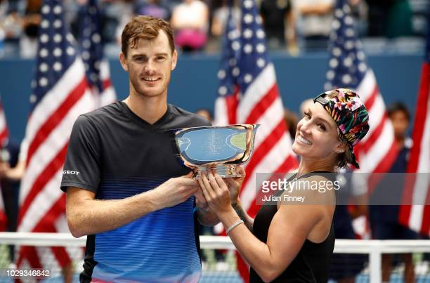 Jamie Murray of Great Britain and Bethanie MattekSands of the United States poses with the trophy after winning the mixed doubles final match against...