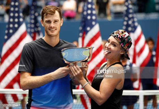 Jamie Murray of Great Britain and Bethanie MattekSands of the United States celebrate with the trophy after winning the mixed doubles final match...