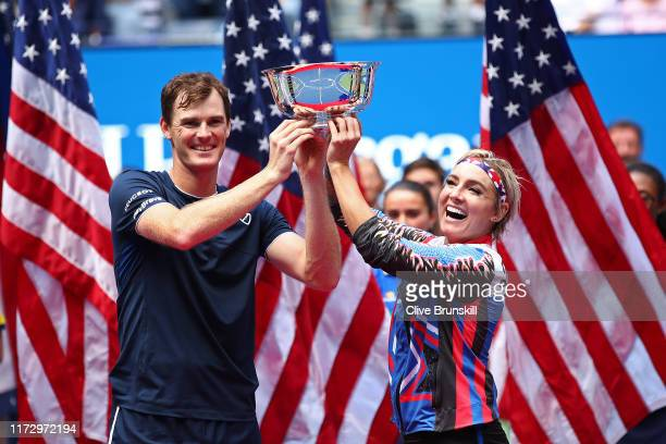 Jamie Murray of Great Britain and Bethanie Mattek-Sands of the United States pose with the trophy after winning their Mixed doubles final match...