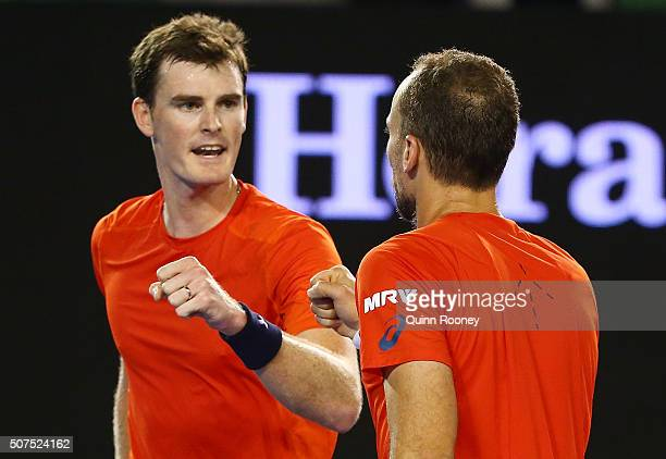 Jamie Murray of Great Britain and Bruno Soares of Brazil celebrate winning a point during their Men's Double Final match against Daniel Nestor of...
