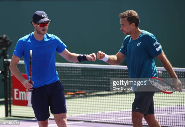Jamie Murray of Great Britain and Bruno Soares of Brazil celebrate a point against Ryan Harrison of the United States and Max Mirnyi of Belarus in...