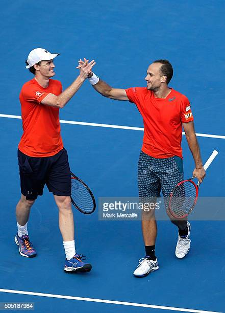 Jamie Murray of Great Britain and Bruno Soares of Brazil celebrate winning championship point in the men's doubles final match against against Rohan...