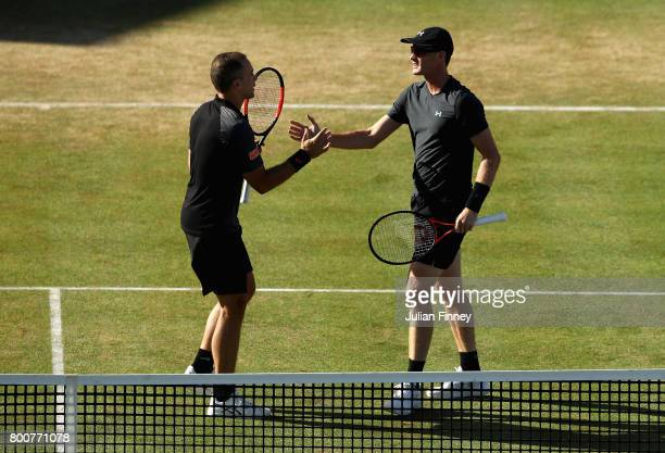 Jamie Murray of Great Britain and Bruno Soares of Brazil celebrate victory during the mens singles semi-final match against Marcin Matkowski of...