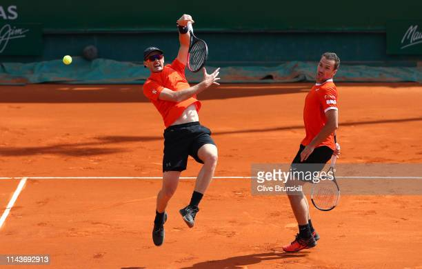 Jamie Murray of Great Britain and Bruno Soares of Brazil in action against Diego Schwartzman of Argentina and Joao Sousa of Portugal in their doubles...