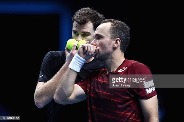 Jamie Murray of Great Britain and Bruno Soares of Brazil pose for a photo after their men's doubles semi final against Raven Klaasen of South Africa...