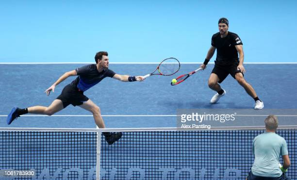 Jamie Murray of Great Britain and Bruno Soares of Brazil return the ball during their round robin match against Henri Kontinen of Finland and John...