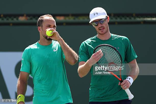 Jamie Murray of Great Britain and Bruno Soares of Brazil talk tactics in their match against Dominic Inglot of Great Britain and Robert Lindstedt of...