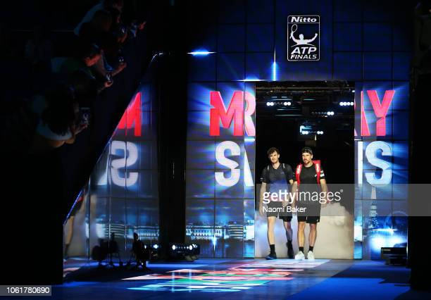 Jamie Murray of Great Britain and Bruno Soares of Brazil walk out onto the court ahead of their match against Henri Kontinen of Finland and John...