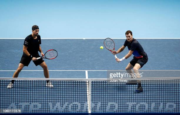 Jamie Murray of Great Britain and Bruno Soares of South Africa in action during their match against Michael Venus of New Zealand and Raven Klaasen of...