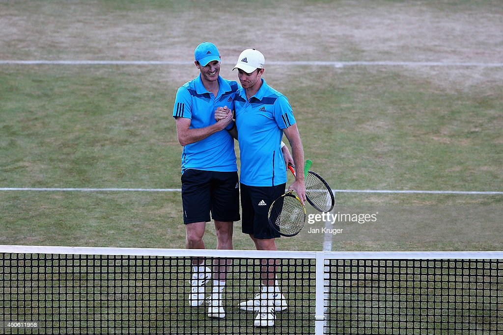 Jamie Murray (blue cap) of Great Britain and John Peers (white cap) of Australia defeat Julien Benneteau of France and Edouard Roger-Vasselin of France during their Men's Doubles semi-final match on day six of the Aegon Championships at Queens Club on June 14, 2014 in London, England.