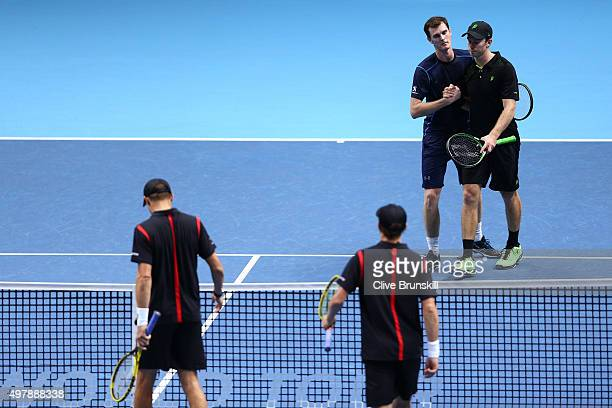 Jamie Murray of Great Britain and John Peers of Australia look dejected after losing to Mike Bryan of the USA and Bob Bryan of the USA in their men's...