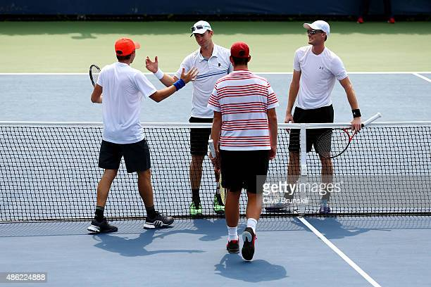 Jamie Murray of Great Britain and John Peers of Australia shake hands with Bjorn Fratangelo and Dennis Novikov of the USA after their Men's Doubles...