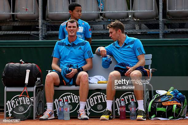 Jamie Murray of Great Britain and John Peers of Australia talk during a break in their men's doubles match against Vasek Pospisil of Canada and...