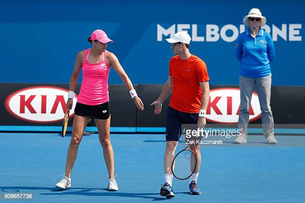 Jamie Murray of Great Britain and Katarina Srebotnik of Slovakia compete in their second round match against AnnaLena Groenfeld and Robert Farah of...