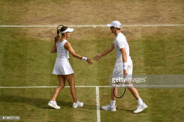 Jamie Murray of Great Britain and Martina Hingis of Switzerland celebrate a point during the Mixed Doubles quarter final match against Ken Skupski of...