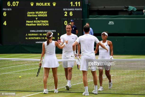 Jamie Murray of Great Britain and Martina Hingis of Switzerland and Heather Watson of Great Britain and Henri Kontinen of Finland shake hands after...