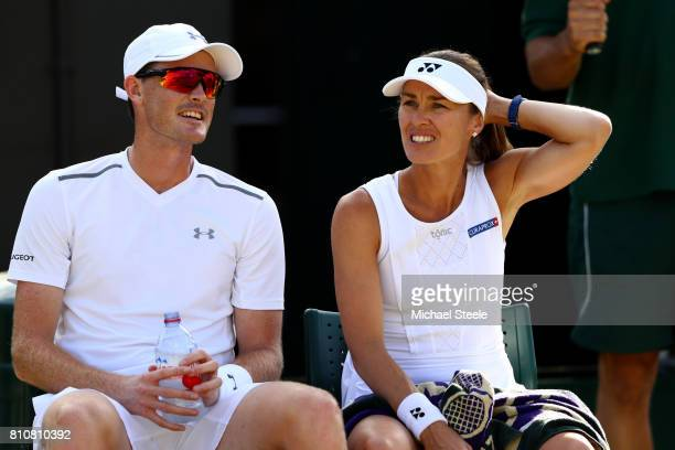 Jamie Murray of Great Britain and Martina Hingis of Switzerland in discussion as they take a break during the Mixed Doubles second round match...