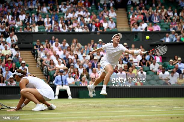 Jamie Murray of Great Britain and Martina Hingis of Switzerland in action during the Mixed Doubles quarter final match against Ken Skupski of Great...
