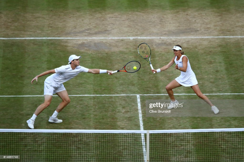 Jamie Murray of Great Britain and Martina Hingis of Switzerland in action during the Mixed Doubles semi final match against Marcelo Demoliner of Brazil and Maria Jose Martinez Sanchez of Spain and on day eleven of the Wimbledon Lawn Tennis Championships at the All England Lawn Tennis and Croquet Club at Wimbledon at Wimbledon on July 14, 2017 in London, England.