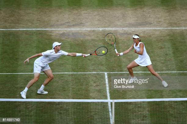 Jamie Murray of Great Britain and Martina Hingis of Switzerland in action during the Mixed Doubles semi final match against Marcelo Demoliner of...