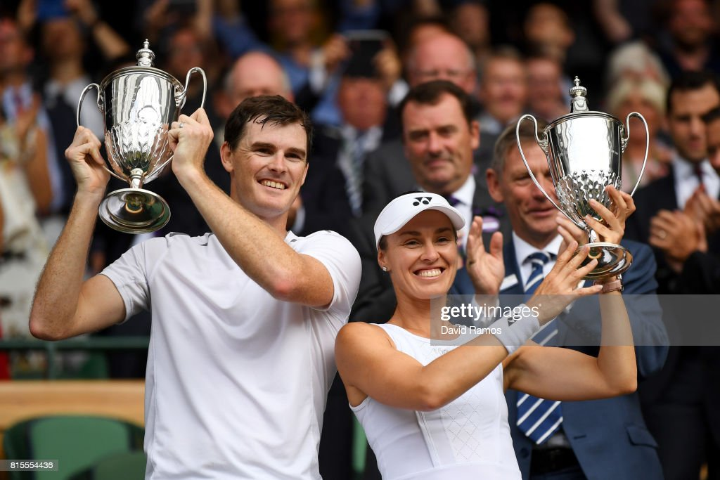 Jamie Murray of Great Britain and Martina Hingis of Switzerland celebrate victory with their trophies after the Mixed Doubles final match against Heather Watson of Great Britain and Henri Kontinen of Finland on day thirteen of the Wimbledon Lawn Tennis Championships at the All England Lawn Tennis and Croquet Club at Wimbledon on July 16, 2017 in London, England.