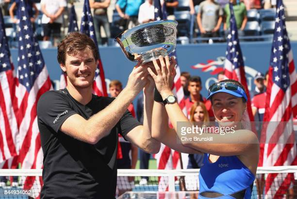 Jamie Murray of Great Britain and Martina Hingis of Switzerland pose during the trophy presentation after defeating HaoChing Chan of Taiwan and...