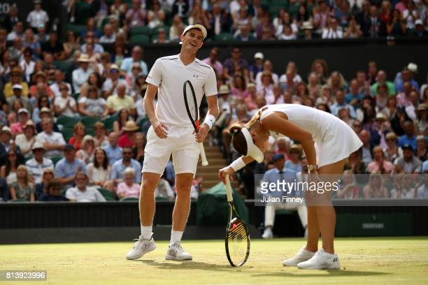 Jamie Murray of Great Britain and Martina Hingis of Switzerland react during the Mixed Doubles quarter final match against Ken Skupski of Great...