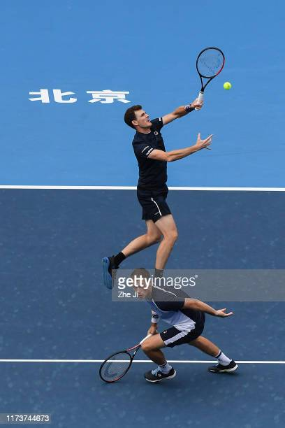 Jamie Murray of Great Britain and Neal Skupski of Great Britain return a shot during their Men's doubles Semifinal match of 2019 China Open against...