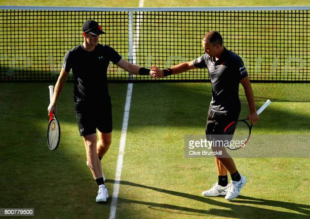 Jamie Murray of Great Britain and partner Bruno Soares of Brazil speak during the mens doubles final against Julien Benneteau of France and Edourd...